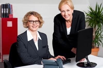 Women Working In Office by stockimages