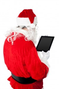 Santa Busy In Operating Tablet Pc by stockimages / FreeDigitalPhotos.net